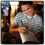 Barcelonesa Sartorialiste Camila signing her page at the Loewe book signing in Barcelona