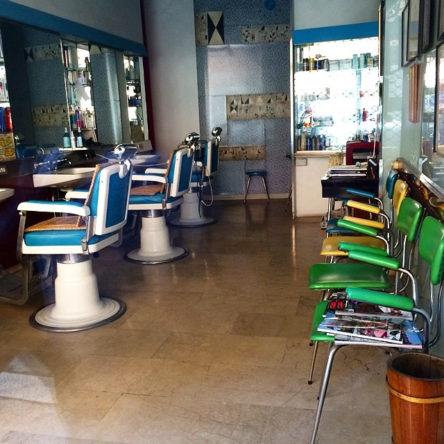 Old barber shop straight from the 1950 s on a small street in