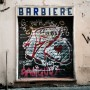 Rome.  I love the contradiction of classic refined and controlled barber shop and the wild, unrefined  energy of the graffiti