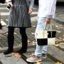 It is very normal here in Shanghai  to see the boyfriend or husband carrying the fancy designer bag for his lady. What does this say about the guy, about the girl, and about their relationship?