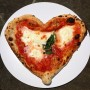 My heart-shaped lunch at Gusta Pizza, Florence.  #TheSartorialistItaly (Eat your heart out! Sorry but I had to go there)